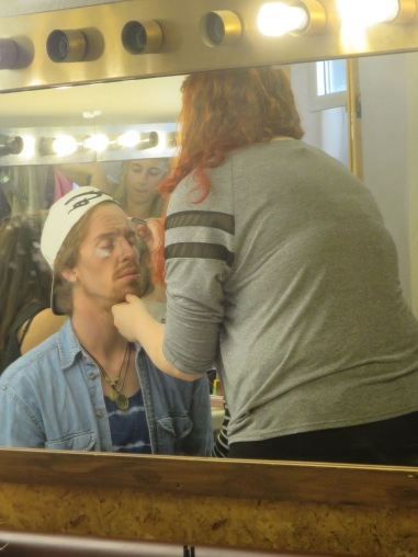 Pierre gets make-up on