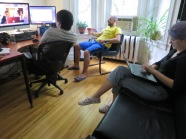 Andre, Jack and Lea the intern sorting out footage